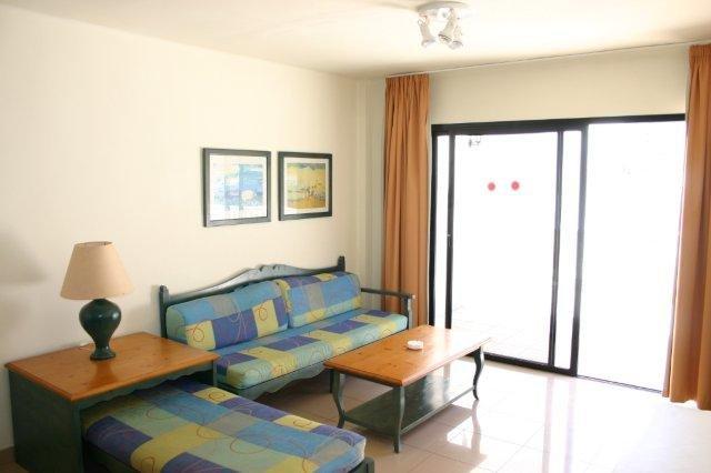 Appartementen Baia del Secreto - woonkamer